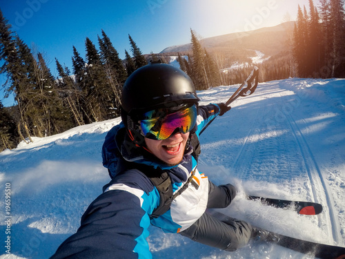 Obrazy Sporty Zimowe  guy-sportsman-goes-on-normal-skiing-on-ski-slope-with-action-camera-sunset-sheregesh-kemerovo
