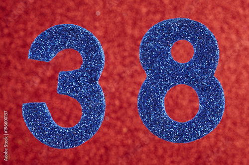 Poster  Number thirty-eight blue color over a red background. Anniversary