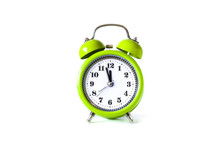 Alarm Clock, Watch Hands Showing  Midnight, Front View. Daylight Saving Time