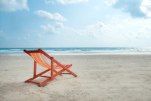 An Orange Beach Chair.