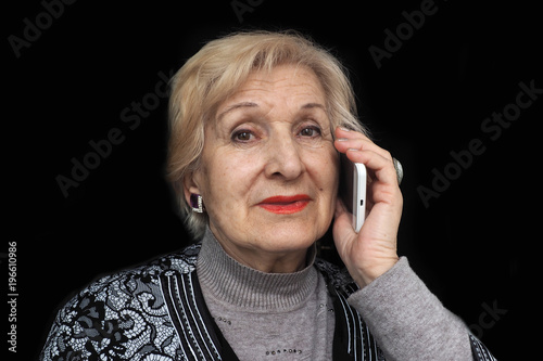 Fotografie, Obraz  Elderly woman communicate with others on white smartphone