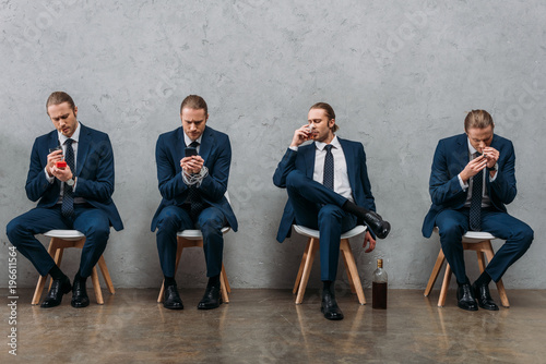 collage of cloned businessman sitting on chairs and showing various addictions Canvas Print