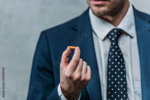 cropped shot of addicted businessman holding drug pill Canvas Print