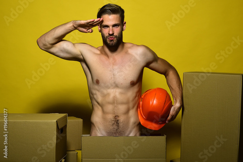 Deurstickers Akt Man with beard isolated on yellow background. Delivery and moving