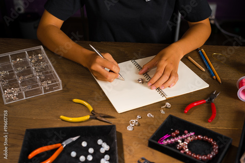 Jewelry Designer Works On A Hand Drawing Sketch Buy This Stock