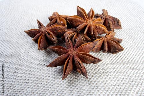Fototapeta Sweet anise star seeds on white background obraz