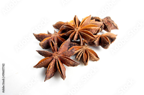 Photo Sweet anise star seeds on white background
