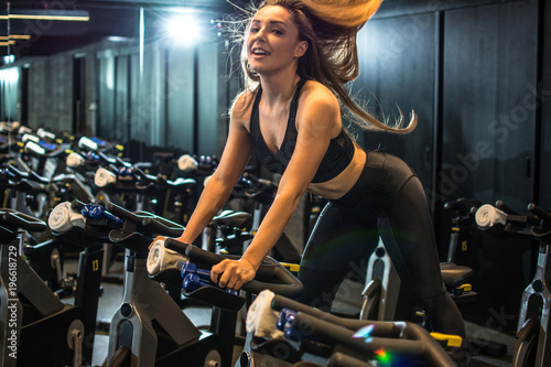 Attractive sporty girl workout in gym.