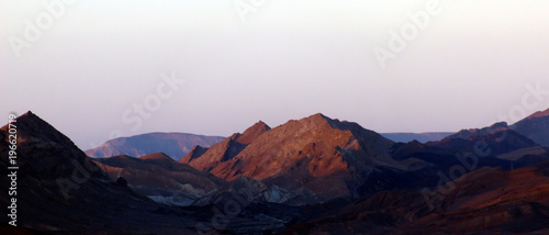 Fototapeta Mountains in the desert at sunrise sunset obraz na płótnie