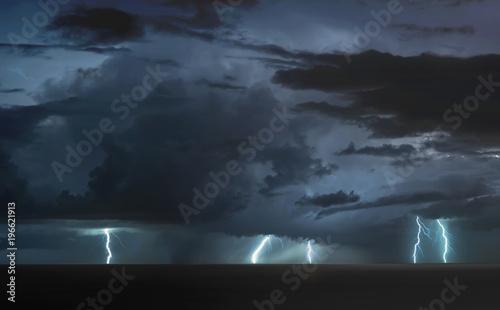 Valokuva  lightning bolts reflection over the sea