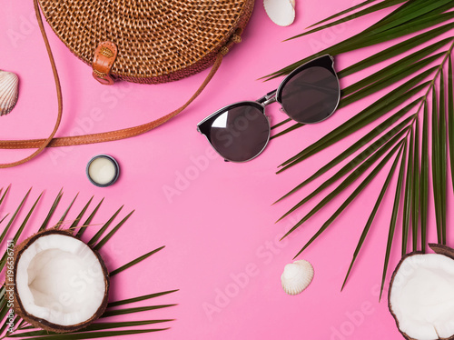 Feminine vacation accessories on the pink background, top view - 196636751