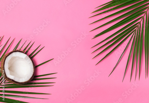 Foto auf Gartenposter Palms Palm leaves and half of coconut on the pink background
