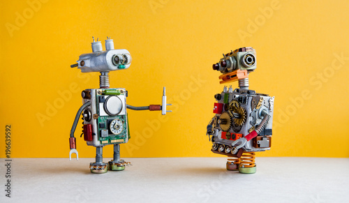 Robots on yellow background Fototapete
