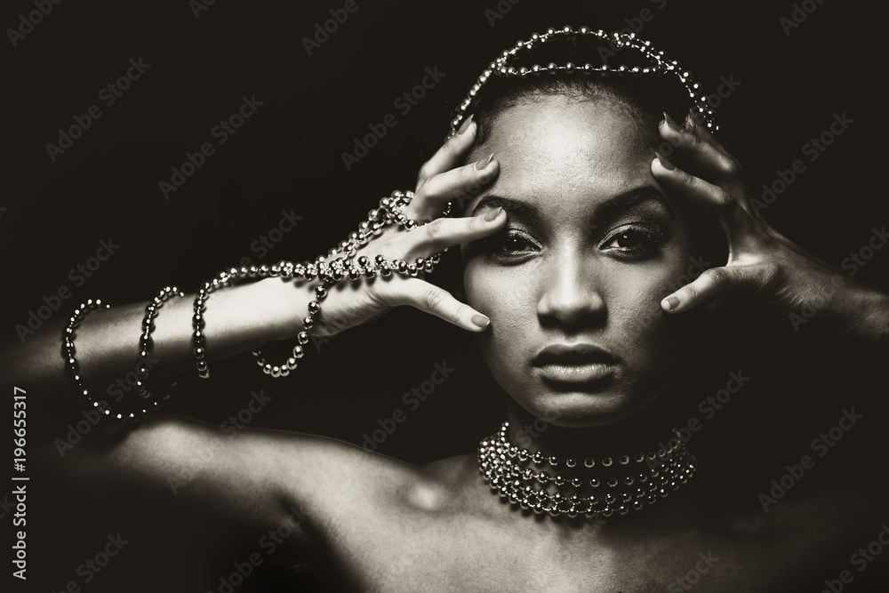 Fototapeta beautiful woman wearing chain jewellery in black and white photo