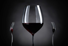 Red Wine And Two Forks.