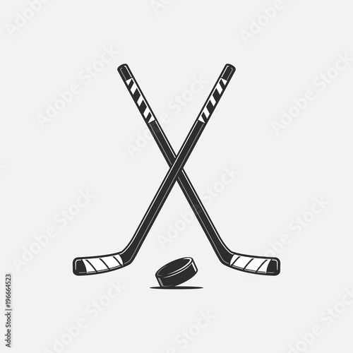Fotomural Crossed hockey sticks and puck vector illustration