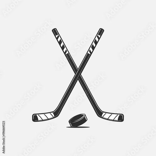 Crossed hockey sticks and puck vector illustration Obraz na płótnie
