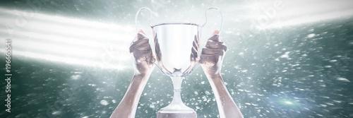 Fototapeta Cropped hand of athlete holding trophy