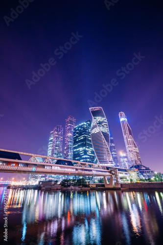 Spoed Foto op Canvas Violet Night Moscow with reflections in the water