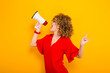canvas print picture - Attractive woman with curly hair with loudspeaker