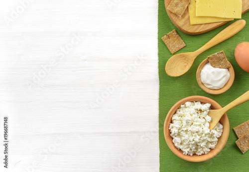 Papiers peints Produit laitier Dairy products on white wooden table.