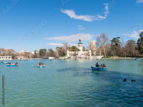 People enjoying a boat ride on the pond in El Retiro Park in Madrid, Spain.