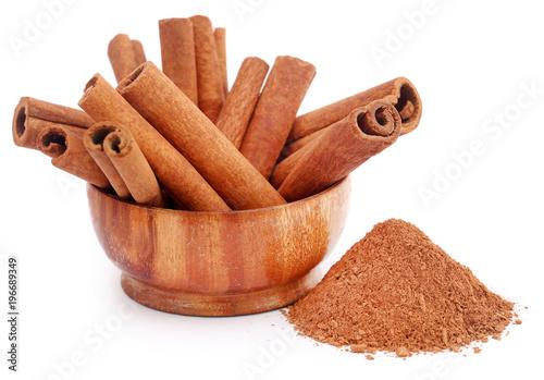 Fototapeta Fresh aromatic cinnamon with powder spice obraz