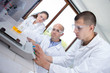 young scientist weighing beaker on electronic scales
