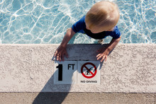 Toddler In A One Foot Deep Baby Pool