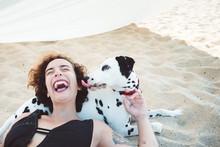 Woman Having Fun With His Dalmatian