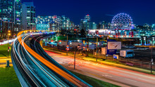 Long Exposure Of Downtown Vancouver, British Columbia, Canada. One Of The Most Vibrant City In North America. Sky Train Lights Trail, Stars And Glitters.