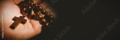 Hand holding rosary beads Wallpaper Mural