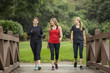 canvas print picture - Group women in their 30s walking together in the outdoors.