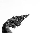 Black And White Naga Statue On...