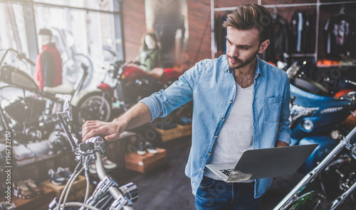 Man in motorcycle shop