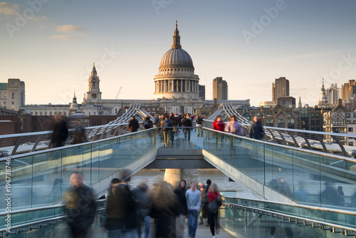 St Pauls Cathedral and the Millennium Bridge landscape with blurred tourists Canvas Print