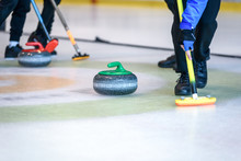 Team Members Play In Curling A...