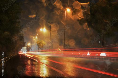 Foto op Plexiglas New York TAXI light trails on rainy night