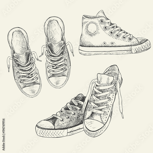 Fotografía  Set of sneakers on the white background drawn in a sketch style