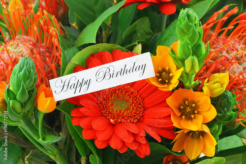 Photo  Happy birthday card with colorful flowers as background