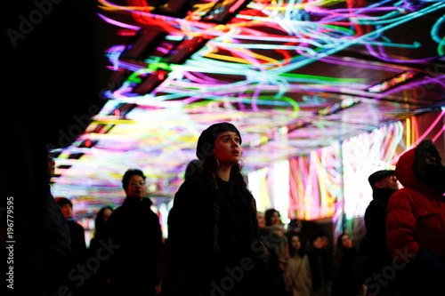 people attend tunnel visions array an installation of light and