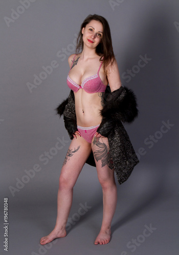 sensual, pretty, big-breasted young woman in pink lingerie and black pelisse Wallpaper Mural