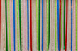 Colorful fabric ribbons play of red blue pink and other colors abstract pattern or texture