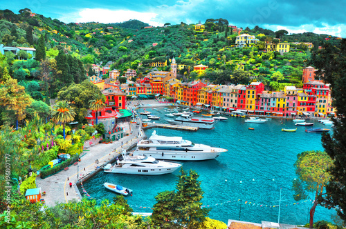 Fotografie, Obraz PORTOFINO , ITALY - MAY 02, 2016: The beautiful Portofino with colorful houses and villas, luxury yachts and boats in little bay harbor