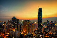 Cityscape At Sunset Sky By Long Shutter Speed In Bangkok City Of Thailand.
