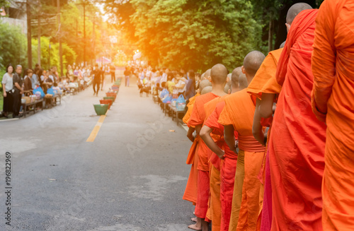 monk walking on street day time. Canvas Print