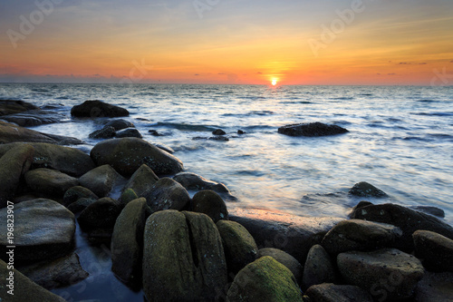 long exposure shooting of small island boat and rock in smoky and soft sea water Poster