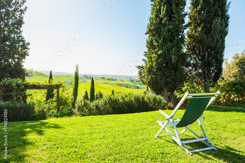 Deurstickers Toscane Chaise lounge on the green meadow. Tuscany, Italy