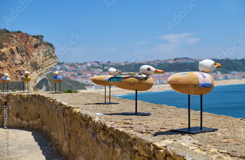 Staande foto Afrika Installation art of seagulls seating on the parapet of Nazare Lighthouse. Nazare. Portugal