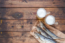 Sun-dried Fish And Beer On A Wooden Background. Selective Focus. Copy Space. Top View